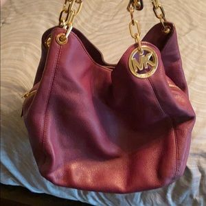Michael Kors purse. Purple with gold accents